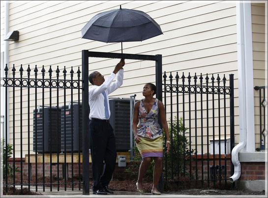U.S. President Barack Obama and first lady Michelle Obama walk through a gate in the Columbia Parc Development to visit newly built homes in New Orleans