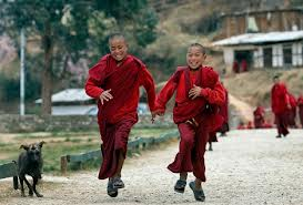 Bhutan young monks running