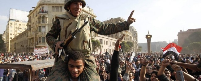 Egyptian soldier carried on the shoulders of protester