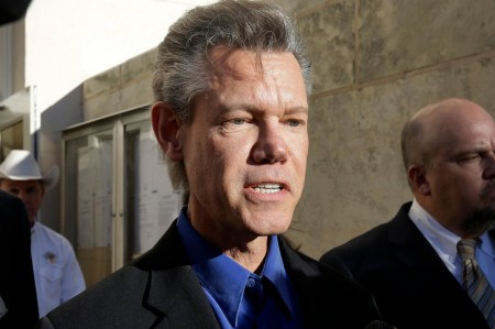 Randy Travis suffers stroke after heart attack.