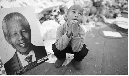 child with Mandela portrait