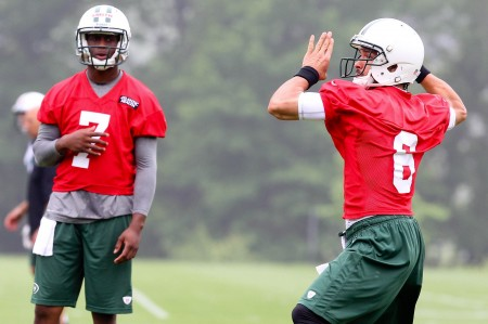 Mark Sanchez (right) will beat out Geno Smith (left) and remain the Jets starting QB.