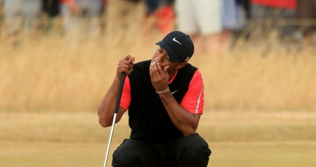 Tiger Woods reacts to his fourth round collapse at the British Open.