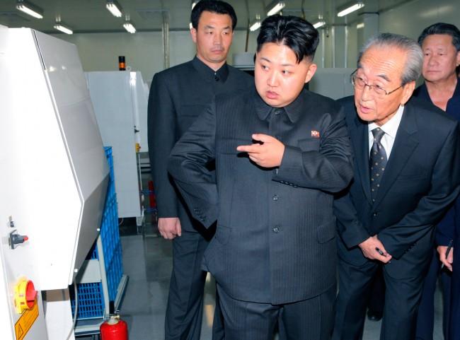 kim jong-un, smartphone, factory