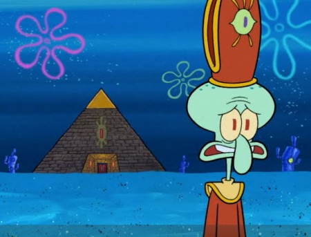 Squidward displays headgear with a disturbing background building.