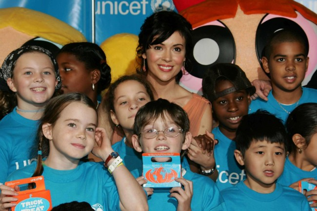 Milano gathers around the children she presents for UNICEF