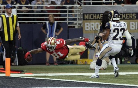 Anquan Boldin dives into the end zone for the San Francisco 49ers during the second quarter of their game against the Rams on Thursday.