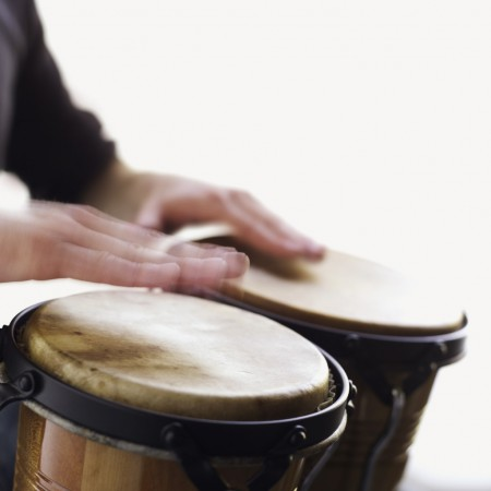 Man playing the bongo drums close-up of hands