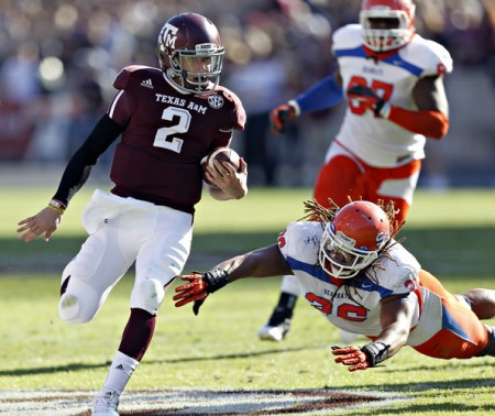 Johnny Manziel showed why he won the Heisman Trophy a year ago with his performance Saturday against Sam Houston.