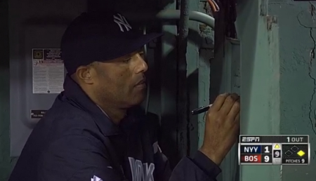 Mariano Rivera signs the visiting bullpen at Fenway while the Red Sox beat the Yankees 9-2 on Sunday.