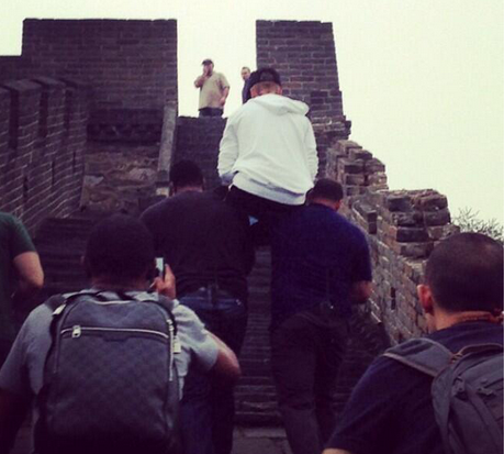 Justin getting carried up the Great Wall of China