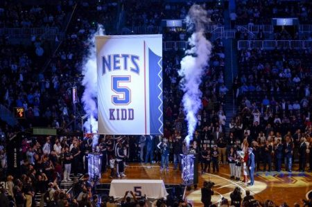 Jason Kidd's jersey is retired by the Nets before a preseason game.