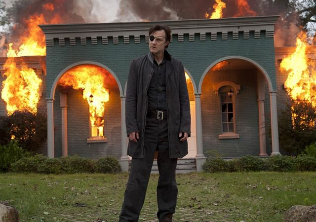 The governor from The Walking Dead, burning down a house