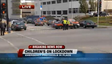 The Children's Hospital of Wisconsin is on lockdown after police shot an armed man who fled from authorities.