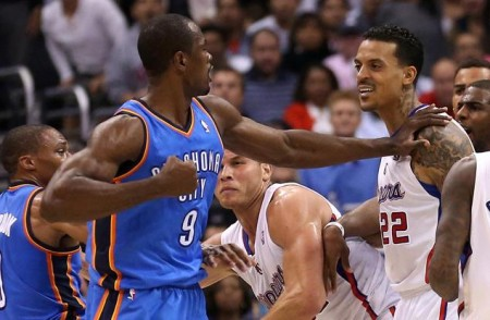 Clippers forward Matt Barnes smiles as Serge Ibaka threatens to punch him, he would later use the N word as part of a Twitter rant about the incident.