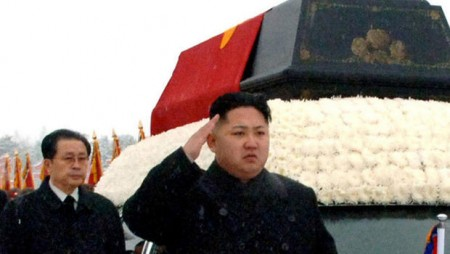 Kim Jong-un and his uncle in a military parade