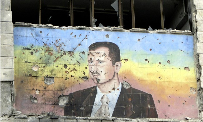 A picture of Syria's President Bashar al-Assad riddled with holes