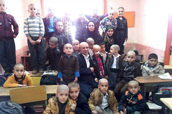 Inspirational  Teacher in Iran Goes Bald to Help Student: Whole Class Follows
