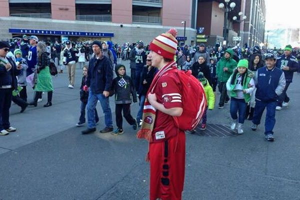 Seahawks 49ers Fans Unite Raise over $18,000 for Homeless Teen