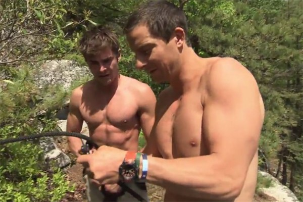 Zac Efron and Bear Grylls Rappel Down Cliff Side [Video]