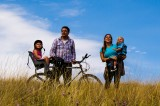 Family Riding E-Bike for Guinness World Record and Green Awareness