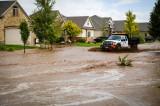 Flood: Two Feet High Waves Rush Through Salt Lake Neighborhood [Video]
