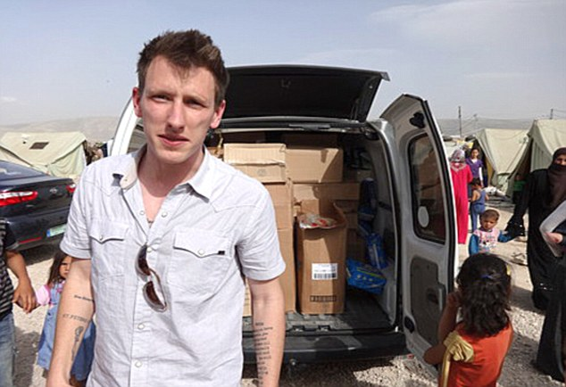 Islamic State Video Claims Another Hostage Beheaded