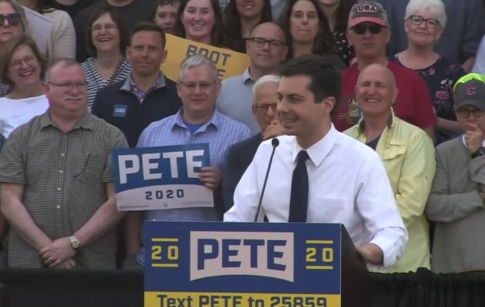 Pete Buttigieg Heckled by Anti-Gay Protesters With Jesus Display [Video]